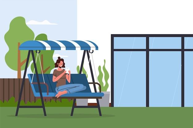 Vrouw die van haar tuinstaycation genieten