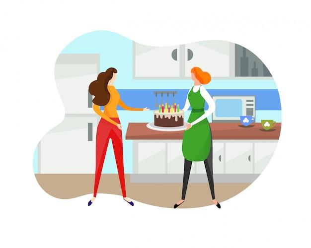 Vrouw die verjaardagstaart geeft aan meisje op keuken.