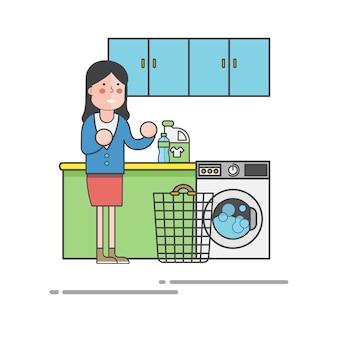 Vrouw die wasserij doet