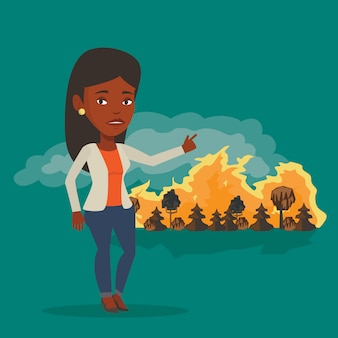 Vrouw die zich op de achtergrond van wildvuur bevindt.