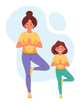 Vrouw doet yoga met dochter