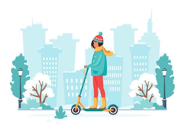 Vrouw elektrische kick scooter rijden in de winter