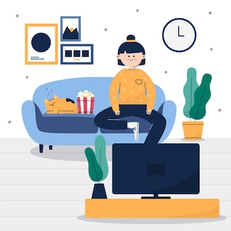 Vrouw en haar kat kijken naar een film