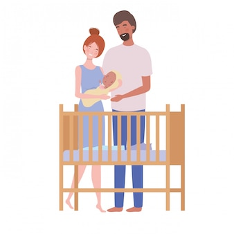 Vrouw en man met pasgeboren baby in de wieg