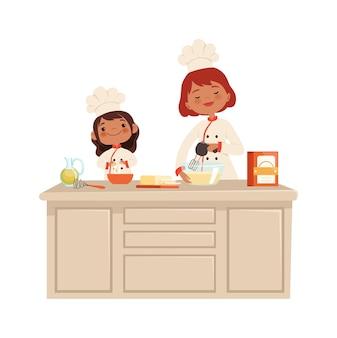 Vrouw en meisje op keuken