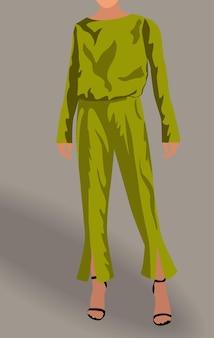 Vrouw gekleed in groene blouse, broek en zwarte hoge hakken.