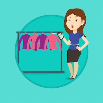 Vrouw geschokt door prijskaartje in kledingwinkel.