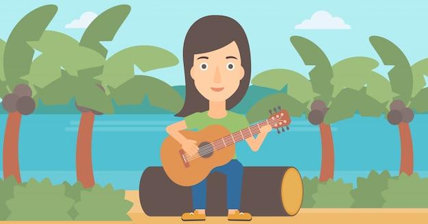 Vrouw gitaar spelen.