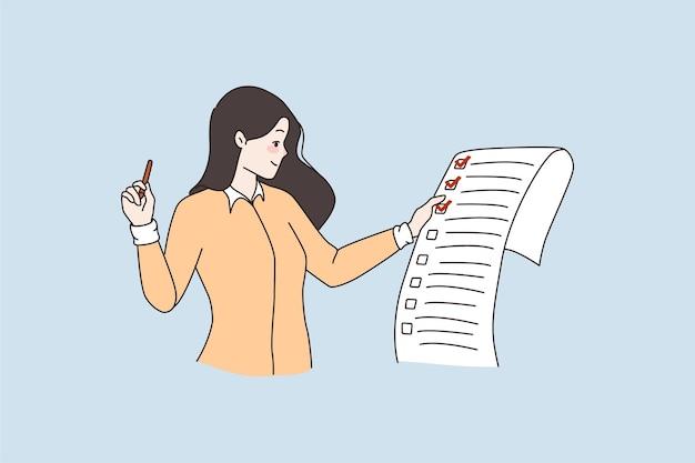 Vrouw houdt papieren cheque vast met voltooide taken met markering