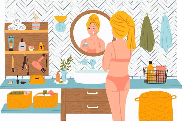 Vrouw in de badkamer