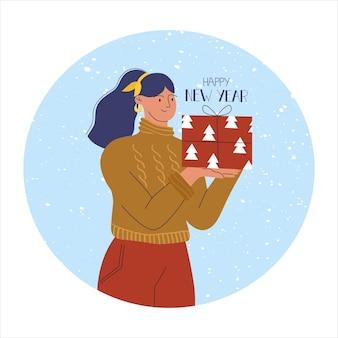 Vrouw in een trui met een nieuwjaarscadeau