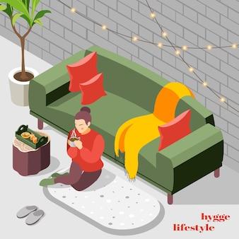 Vrouw in gebreide trui zittend op vloerkleed nippen warme chocolademelk hygge levensstijl isometrische illustratie