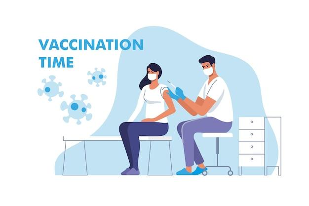 Vrouw in gezichtsmasker wordt ingeënt tegen coronavirus in het ziekenhuis