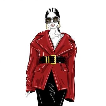 Vrouw in glazen en oversized rode jas