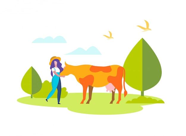 Vrouw in overall strelen koe op veld, landbouw