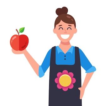 Vrouw in schort en appel in de hand. platte vectorillustratie.