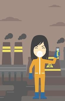 Vrouw in stralings beschermend kostuum met reageerbuis.