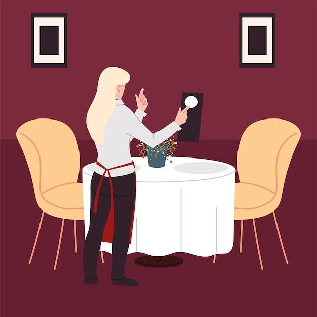 Vrouw in uniform neemt een bestelling op in een restaurant