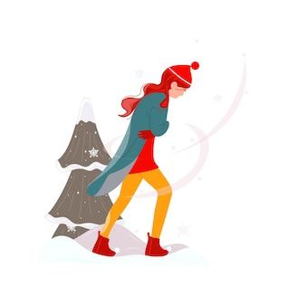 Vrouw in warme seizoenskleding en sneeuwstorm vallende sneeuwvlok