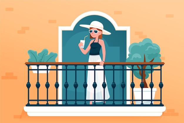 Vrouw in zomer kleding thuis balkon