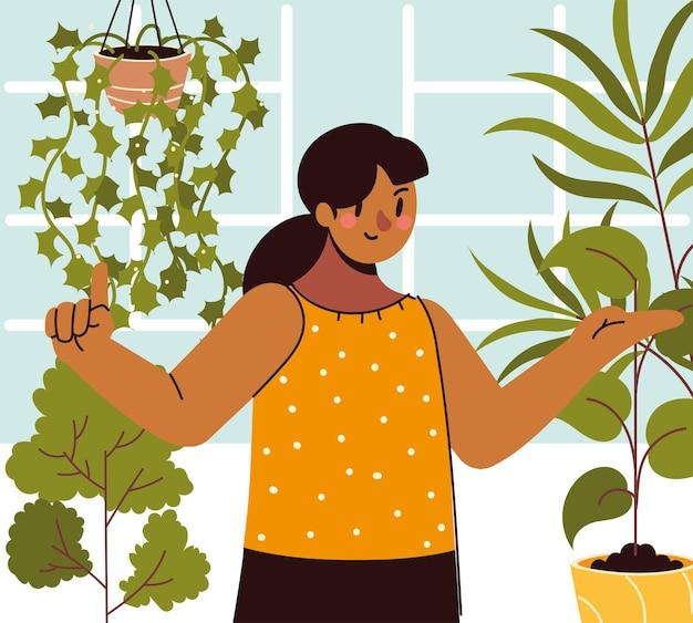 Vrouw kamerplanten in huis