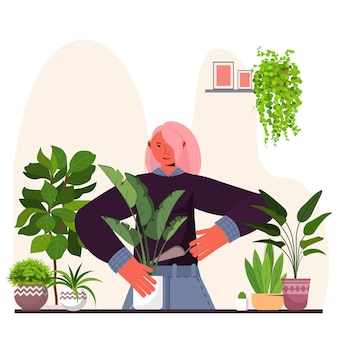 Vrouw kamerplanten planten in pot huisvrouw zorg van haar planten portret