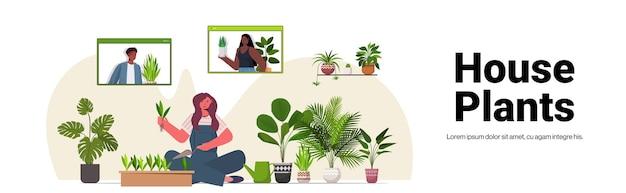 Vrouw kamerplanten planten in pot huisvrouw zorg van haar planten woonkamer interieur horizontale kopie ruimte