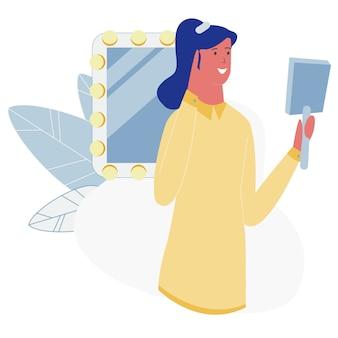 Vrouw kijkt in spiegel bewonder haar nieuwe kapsel