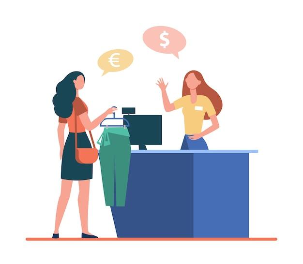 Vrouw kleren in modewinkel kopen, kassier raadplegen aan balie.