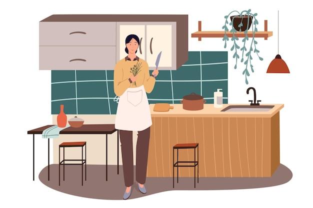 Vrouw koken thuis keuken web concept. huisvrouw in schort snijdt greens met mes, bereidt zelfgemaakte gerechten voor de lunch
