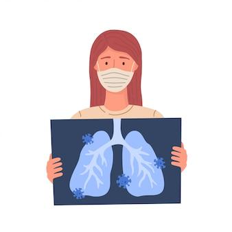 Vrouw krijgt coronavirus. covid-19. vrouw houdt röntgenfoto van longen.