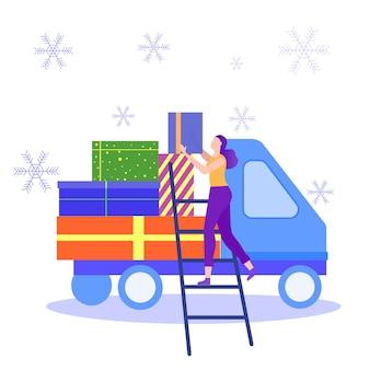 Vrouw laadt geschenkdoos in vrachtwagen.