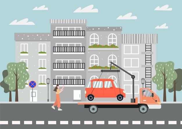 Vrouw loopt achter een sleepwagen met haar auto. verboden parkeren in de stad