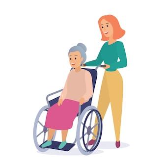 Vrouw maatschappelijk werker op een wandeling met gehandicapte grootmoeder in een rolstoel