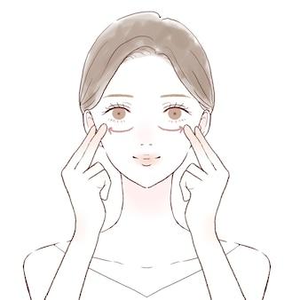 Vrouw masseert over de ogen. op een witte achtergrond.
