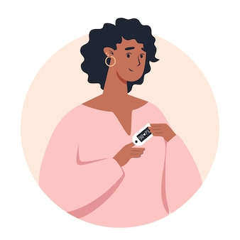Vrouw met behulp van pulsoxymeter apparaat op vinger