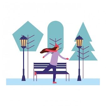 Vrouw met de winterkleren in het park