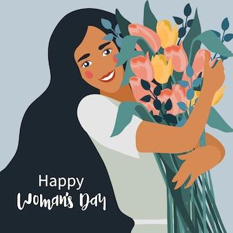Vrouw met een boeket bloemen tulpen