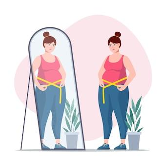 Vrouw met een laag zelfbeeld die in de spiegel kijkt
