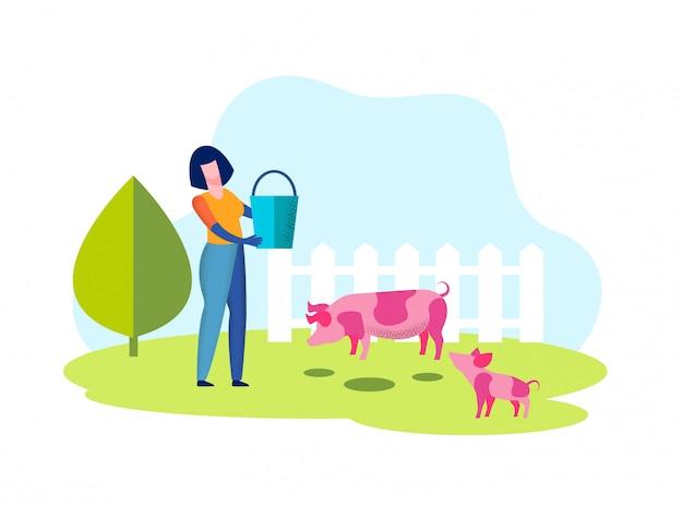 Vrouw met emmer in handen. varken in volière op boerderij.
