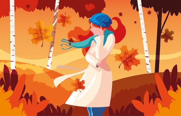 Vrouw met hoed in de herfstlandschap