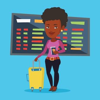 Vrouw met koffer en ticket op de luchthaven.
