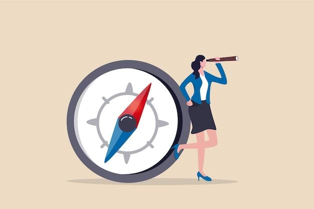 Vrouw met kompas kijken door verrekijker of telescoop