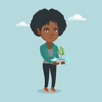 Vrouw met plant groeit in een plastic fles.