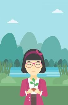 Vrouw met plant vectorillustratie.
