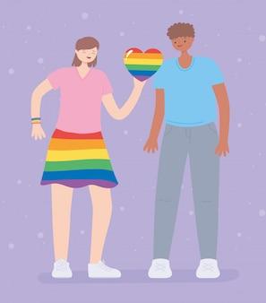 Vrouw met regenboogkleuren en hart en jonge man naast haar