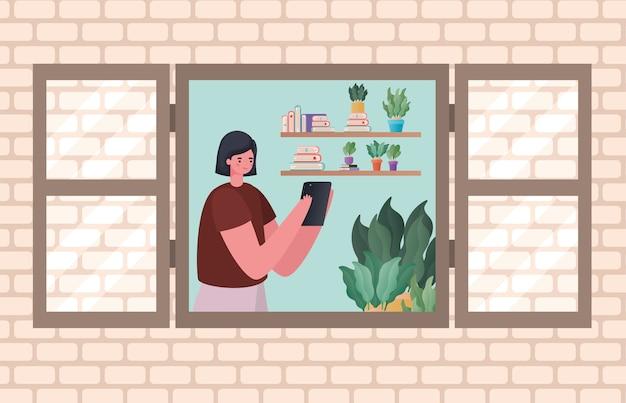Vrouw met tablet die bij vensterontwerp van het thema werk vanuit huis werkt