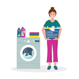 Vrouw met vuile kleren en wasmachine. huisvrouw thuis.