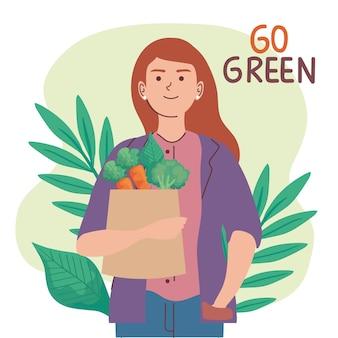 Vrouw met zak groenten