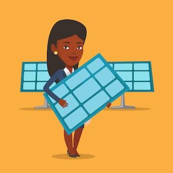 Vrouw met zonnepaneel.